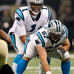 January 1, 2012; New Orleans, LA, USA; Carolina Panthers quarterback Cam Newton (1) under center center Ryan Kalil (67) against the Carolina Panthers during the first quarter of a game at the Mercedes-Benz Superdome. The Saints defeated the Panthers 45-17. Mandatory Credit: Derick E. Hingle-US PRESSWIRE