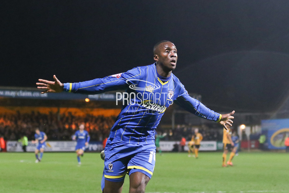 Ade Azeez of AFC Wimbledon celebrates in front of his fans during the Sky Bet League 2 match between Cambridge United and AFC Wimbledon at the R Costings Abbey Stadium, Cambridge, England on 2 January 2016. Photo by Stuart Butcher.