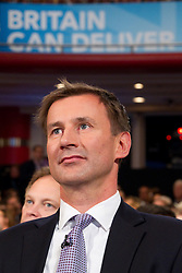 © Licensed to London News Pictures. 09/10/2012. Birmingham , UK . Jeremy Hunt underneath a Britain Can Deliver sign during Boris Johnson 's speech . Day 3 of the Conservative Party Conference at the International Convention Centre in Birmingham . Photo credit : Joel Goodman/LNP