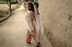A young relative of Mukhtar Mai is seen during a visit to Mai's aunt's house, Meerwala, Pakistan, April 28, 2005. Mai, 33, went against the Pakistani tradition of committing suicide when she brought charges against the men who gang raped her nearly three years ago.