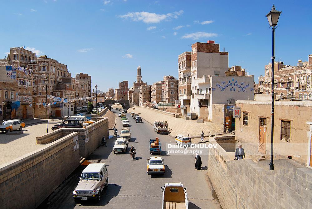 SANAA, YEMEN - SEPTEMBER 09, 2006: Unidentified people walk by the street of Sanaa city in Sanaa, Yemen. The old city of Sanaa is a UNESCO World heritage site.
