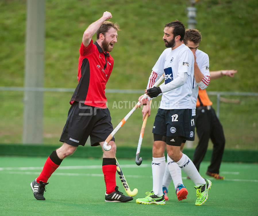 Southgate's Mike Houlihan celebrates scoring the equaliser. Southgate v East Grinstead - Now: Pensions Hockey League Premier Division, Trent Park, London, UK on 01 February 2015. Photo: Simon Parker