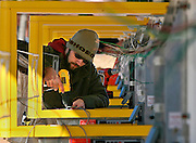 Arkansas Democrat-Gazette/BOB COLEMAN<br /> Josh Wheeler of Fayetteville, an employee of Sonic Drive Ins, wires ordering boards at the Sonic on Sixth Street in Fayetteville Tuesday afternoon. The restaurant, which has been closed for remodeling, is expected to reopen Monday, Dec. 8th.  12/3/08