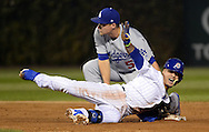 CHICAGO, IL - OCTOBER 15:  Javier Baez #9 of the Chicago Cubs slides safely into second base with a double in the second inning of Game 1 of NLCS against the Los Angeles Dodgers at Wrigley Field on Saturday, October 15, 2016 in Chicago, Illinois. (Photo by Ron Vesely/MLB Photos via Getty Images) *** Local Caption *** Javier Baez