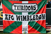 Wimbledon sign during the EFL Sky Bet League 1 match between AFC Wimbledon and Rochdale at the Cherry Red Records Stadium, Kingston, England on 30 September 2017. Photo by Matthew Redman.