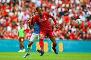 Liverpool defender Virgil van Dijk (4) holds off Manchester City striker Gabriel Jesus (33) during the FA Community Shield match between Manchester City and Liverpool at Wembley Stadium, London, England on 4 August 2019.