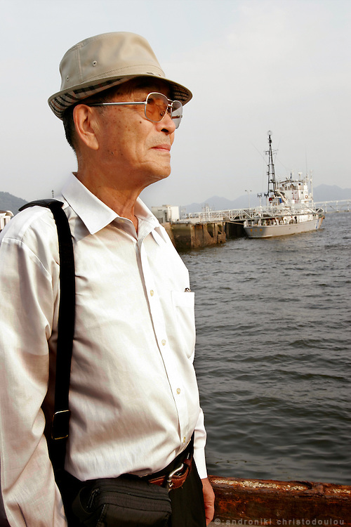 ISAO WADA. Hiroshima A-Bomb survivor - Trained to be a sea kamikaze. Photo: at the old port of Hiroshima and at the spot where he arrived on August 6 1946.