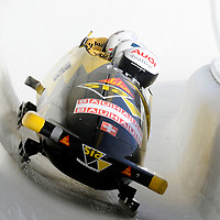 28 February 2007:     The Switzerland 1 bobsled driven by Ivo Rueegg with sidepushers Roman Handschi and Thomas Lamparter, and brakeman Cédric Grand goes through turn 19 in the 1st run at the 4-Man World Championships competition on February 27 at the Olympic Sports Complex in Lake Placid, NY.