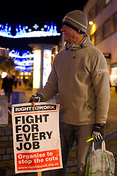 © under license to London News Pictures.  16/12/2010 A man braves the cold weather to attend a demonstration in Plymouth city centre this evening (16/12/2010) against public sector cuts. Picture credit should read: David Hedges/LNP