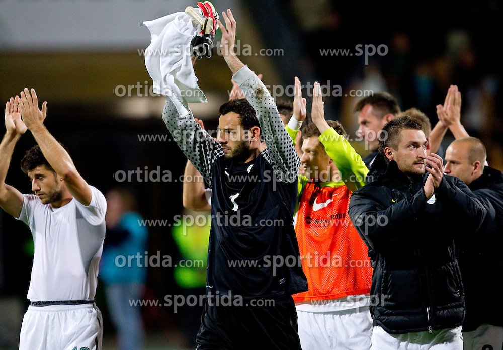Bojan Jokic, Samir Handanovic, Armin Bacinovic of Slovenia after the football match between National Teams of Slovenia and Serbia of UEFA Euro 2012 Qualifying Round in Group C on October 11, 2011, in Stadium Ljudski vrt, Maribor, Slovenia.  Slovenia defeated Serbia 1-0. (Photo by Vid Ponikvar / Sportida)