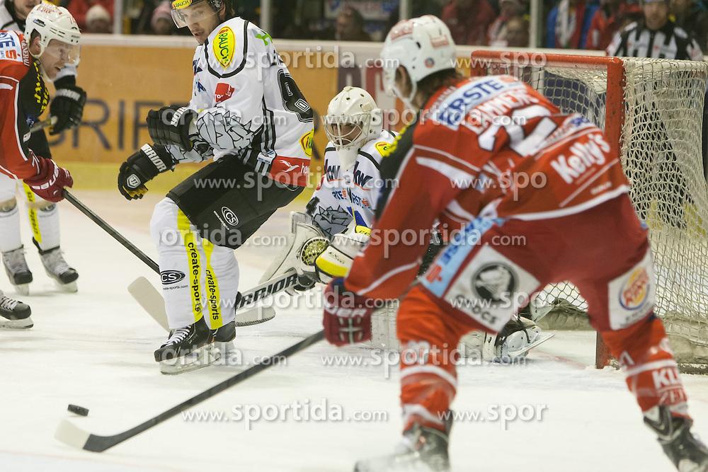 08.12.2013, Stadthalle, Klagenfurt, AUT, EBEL, KAC vs die Dornbirner, 49. Runde, im Tor zum 1: 0 für den KAC durch John Lammers (Kac, #20) Bild Jamie Lundmark (Kac, #74), Robert Lembacher (Dornbirner Bulldogs, #81), Adam Dennis (Dornbirner Bulldogs, #44), John Lammers (Kac, #20)// during the Erste Bank Icehockey League 49th Round match betweeen EC KAC and die Dornbirner at the City Hall, Klagenfurt, Austria on 2013/12/08. EXPA Pictures © 2013, PhotoCredit: EXPA/ Gert Steinthaler