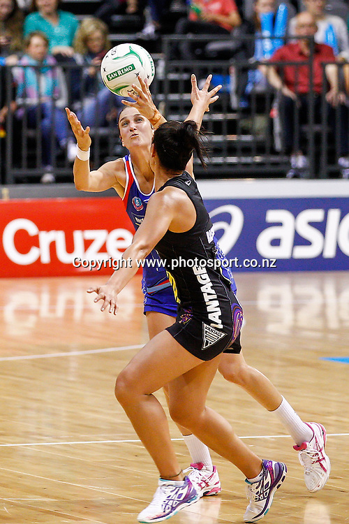 Waikato BOP Magic's Grace Rasmussen and Northern Mystic's Anna Harrison compete for the ball during the ANZ Championship netball match - Waikato BOP Magic v Northern Mystics at Claudelands Arena, Hamilton, New Zealand on Saturday 20 April 2014.  Photo:  Bruce Lim / www.photosport.co.nz