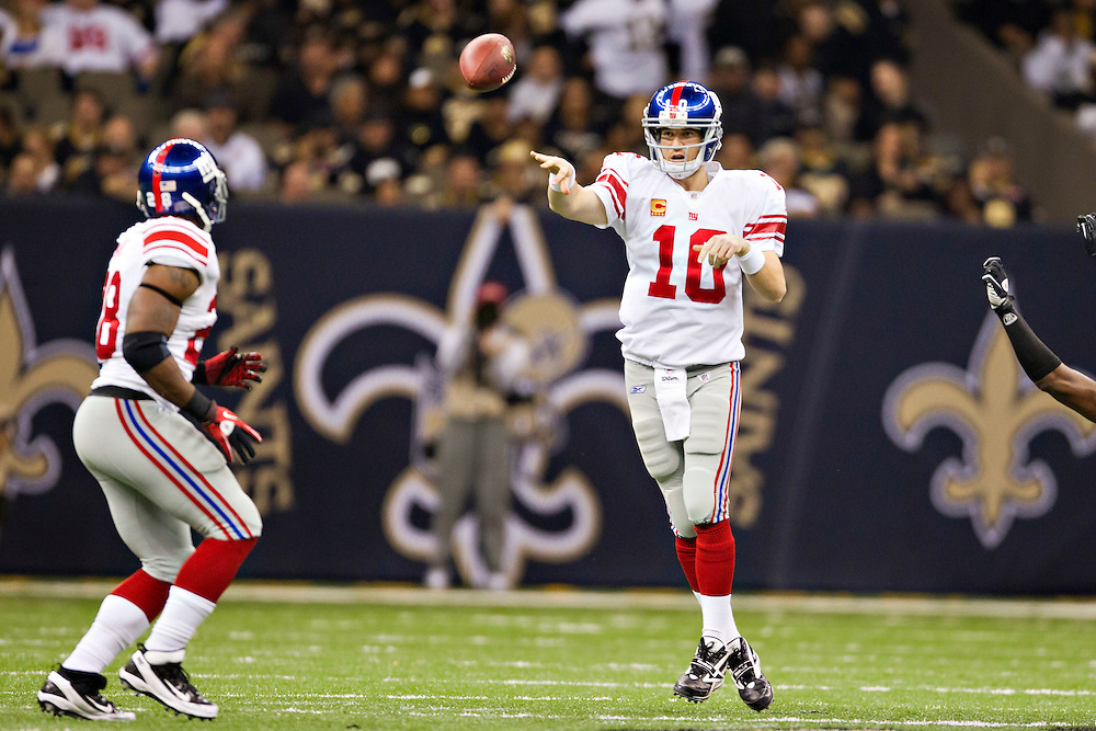 NEW ORLEANS, LA - NOVEMBER 28:   Quarterback Eli Manning #10 throws a pass to D.J. Ware #28 of the New York Giants during a game against the New Orleans Saints at Mercedes-Benz Superdome on November 28, 2011 in New Orleans, Louisiana.  The Saints defeated the Giants 49-24.  (Photo by Wesley Hitt/Getty Images) *** Local Caption *** D.J. Ware; Eli Manning