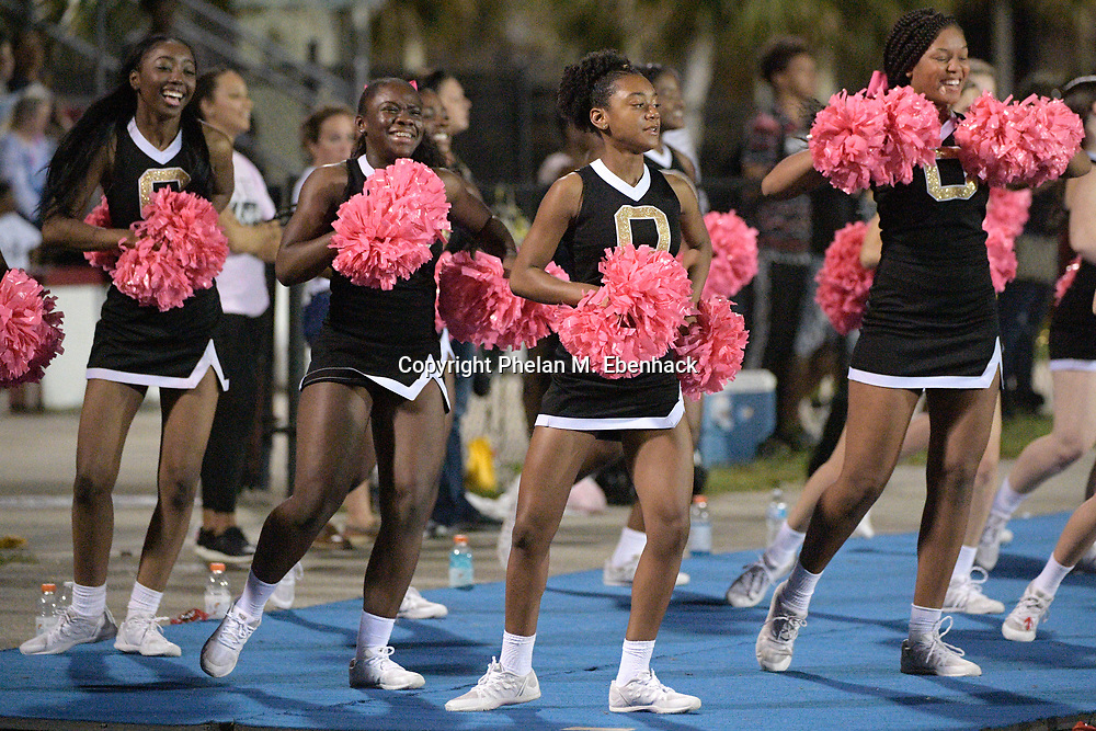Ocoee cheerleaders perform during the second half of a high school football game against Edgewater Monday, Oct. 9, 2017, in Orlando, Fla. Edgewater won 44-29. (Photo by Phelan M. Ebenhack)