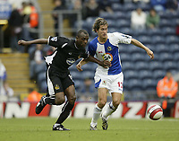 Photo: Aidan Ellis.<br /> Blackburn Rovers v Wigan Athletic. The Barclays Premiership. 01/10/2006.<br /> Blackburn's Morten Gamst Pedersen battles with Wigan's Henri Camara