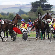 Horse and riders prepare themselves at the start line during the Winton Harness Racing Club Race meeting at the Central Southland Raceway, WInton, Southland, New Zealand. 10th February 2012. Photo Tim Clayton