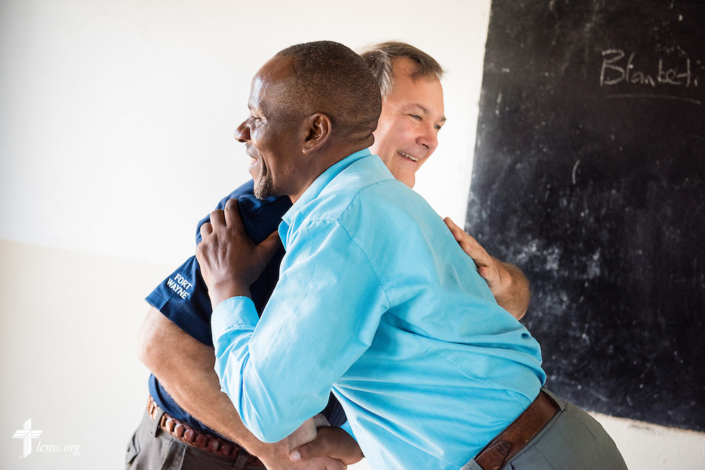 A pastoral student hugs the Rev. Dr. Lawrence R. Rast, Jr., president of Concordia Theological Seminary in Fort Wayne, Ind., following one of the last classes for the student at the Evangelical Lutheran Church in Tanzania – South-East of Lake Victoria Diocese (ELCT-SELVD) Bishop Emmanuel Makala Training Center on Friday, March 13, 2015, in Shinyanga, Tanzania. LCMS Communications/Erik M. Lunsford