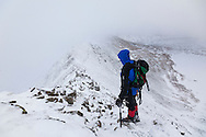 An ice axe and crampons are a neccessity in full winter conditions when descending Swirral Edge