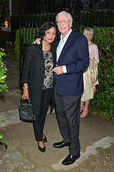 SIR MICHAEL & LADY CAINE attending Annabel Goldsmith's Summer party held at her home in Ham, Surrey on 10th July 2014.
