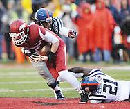 Arkansas Razorbacks quarterback Austin Allen (8) is sacked by Ole Miss Rebels defensive end Fadol Brown (90) and Ole Miss Rebels defensive back Senquez Golson (21) at Donald W. Reynolds Razorback Stadium in Fayetteville, Ark. on Saturday, November 22, 2014.