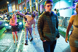 © Licensed to London News Pictures . 01/01/2016 . Manchester , UK . A man slips on the contents of a spilled kebab on the pavement . Revellers in Manchester on a New Year night out at the clubs around the city centre's Printworks venue . Photo credit : Joel Goodman/LNP