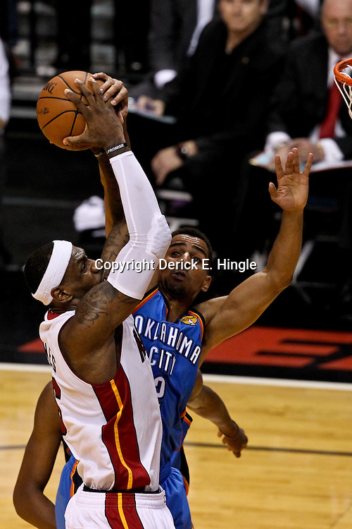 Jun 19, 2012; Miami, FL, USA; Miami Heat small forward LeBron James (6) shoots over Oklahoma City Thunder shooting guard Thabo Sefolosha (2) during the first quarter in game four in the 2012 NBA Finals at the American Airlines Arena. Mandatory Credit: Derick E. Hingle-US PRESSWIRE