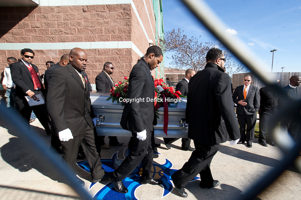 Dec 22, 2009; Westwego, LA, USA;  Family members carry the casket out during funeral services for Cincinnati Bengals wide receiver Chris Henry held at the Alario Center. Mandatory Credit: Derick E. Hingle-US PRESSWIRE