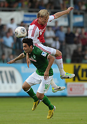 19-07-2013 VOETBAL: WERDER BREMEN - AFC AJAX: MEPPEN<br /> Mehmet Ekici (Bremen #10), Christian Poulsen (Amsterdam #6)<br /> ***NETHERLANDS ONLY***<br /> ©2013-FotoHoogendoorn.nl