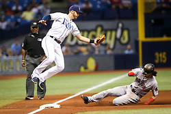 September 16, 2017 - St. Petersburg, Florida, U.S. - WILL VRAGOVIC       Times.Boston Red Sox left fielder Andrew Benintendi (16) steals third as Tampa Bay Rays third baseman Evan Longoria (3) leaps for the throw in the sixth inning of the game between the Boston Red Sox and the Tampa Bay Rays at Tropicana Field in St. Petersburg, Fla. on Saturday, Sept. 16, 2017. (Credit Image: © Will Vragovic/Tampa Bay Times via ZUMA Wire)