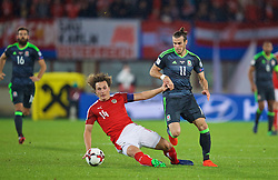 VIENNA, AUSTRIA - Thursday, October 6, 2016: Wales' Gareth Bale in action against Austria's captain Julian Baumgartlinger during the 2018 FIFA World Cup Qualifying Group D match at the Ernst-Happel-Stadion. (Pic by David Rawcliffe/Propaganda)