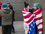 "28 NOVEMBER 2019 - ANKENY, IOWA: COURTNEY POUS-OJEDA and her son XAVIER POUS-OJEDA share a blanket to stay warm while they wait for the Target store in Ankeny, Iowa, top open. ""Black Friday"" is the unofficial start of the Christmas holiday shopping season and has traditionally thought to be one of the busiest shopping days of the year. Brick and mortar retailers, like Target, are facing increased pressure from online retailers this year. Many retailers have started opening on Thanksgiving Day. Target stores across the country opened at 5PM on Thanksgiving to attract shoppers with early ""Black Friday"" specials.       PHOTO BY JACK KURTZ"