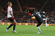Liverpool forward Christian Benteke with a shot during the Barclays Premier League match between Sunderland and Liverpool at the Stadium Of Light, Sunderland, England on 30 December 2015. Photo by Simon Davies.