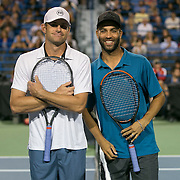August 21, 2014, New Haven, CT:<br /> Andy Roddick and James Blake pose for a photograph at net before playing each other during the Men's Legends Event on day seven of the 2014 Connecticut Open at the Yale University Tennis Center in New Haven, Connecticut Thursday, August 21, 2014.<br /> (Photo by Billie Weiss/Connecticut Open)