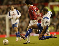 Photo: Aidan Ellis.<br /> Manchester United v Portsmouth. The FA Cup. 27/01/2007.<br /> Pompey's Glenn Johnson challenges United's Ji Sung Park