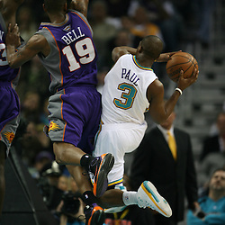 Chris Paul #3 for the New Orleans Hornets shoots around Raja Bell #19 of the Phoenix Suns on February 26, 2008 at the New Orleans Arena in New Orleans, Louisiana. The New Orleans Hornets defeated the Phoenix Suns 120-103.