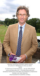 Olympic shooting champion SIMON WARD at a shoot in Middlesex on 3rd July 2003.<br /> PLD 5