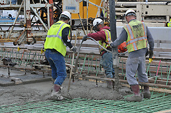 Three Workers on a Concrete Pour at the New Pearl Harbor Memorial Bridge, New Haven Harbor Crossing Corridor. CT DOT Contract B1 Project No. 92-618 Progress Photography. East end of the Northbound West Approaches. Eighth on site photo capture of every four month chronological documentation.