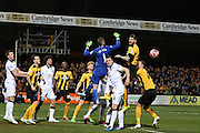Manchester United's Goalkeeper David De Gea punches clear during the The FA Cup match between Cambridge United and Manchester United at the R Costings Abbey Stadium, Cambridge, England on 23 January 2015. Photo by Phil Duncan.