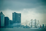 Square rigger ship in upper NY Harbor with lower Manhattan and Brookly Bridge visible