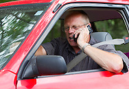 Paul Hannam of St Ansgar talks on the phone with a former employee of PFGBest outside PFGBest in Cedar Falls, Iowa on Tuesday, July 10, 2012. Hannam is an electrical vendor who serviced PFGBest.