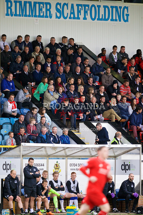 SOUTHPORT, ENGLAND - Wednesday, August 19, 2015: Scouts and agents watch from the stands during the Under 21 FA Premier League match between Everton and Liverpool at Haig Avenue. (Pic by David Rawcliffe/Propaganda)