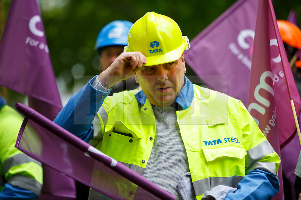 © Licensed to London News Pictures. 25/05/2016. London, UK. Tata steelworkers join hundreds of steelworkers from across the UK to march through Westminster in London to keep up pressure for government help steel industry on Wednesday, 25 May 2016. Photo credit: Tolga Akmen/LNP