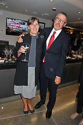 GRIFF RHYS JONES and his wife JO at the opening of the new St.James Theatre, 12 Palace Street, London SW1 on 13th September 2012.