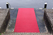 plastic red carpet at boot landing