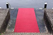 plastic red carpet at boot landing