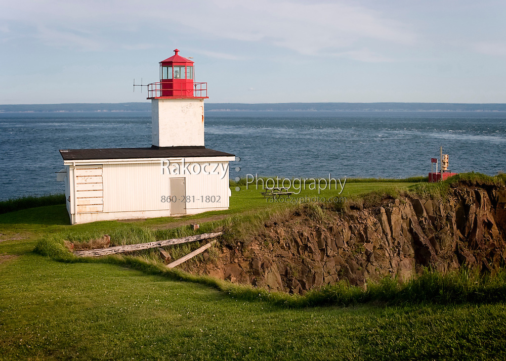 The Cape D'Or lighthouse stands watch over the steep cliffs at the inlet to the Bay of Fundy in Nova Scotia, Canada.