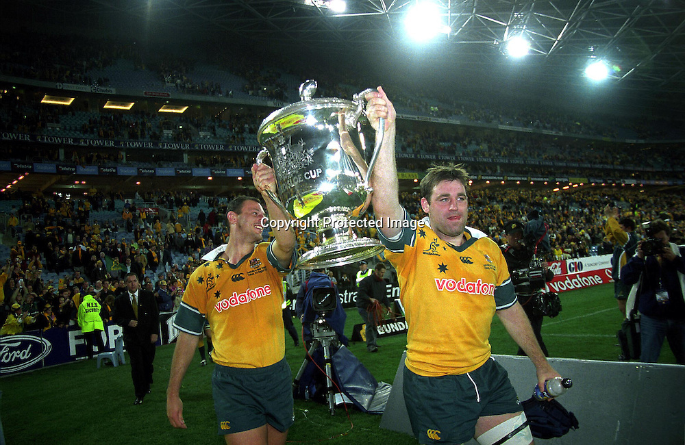 David Lyons and Matt Cockbain celebrate after the rugby union Bledisloe Cup match between the All Blacks and Australia, Syndey, 3 August 2002. Photo: PHOTOSPORT