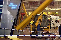 "An excavator at the scene after a raid on  350 million of diamonds on show at the Millennium Dome in SE London.  Six people were arrested, including four in the Money zone vault, and two by the River Thames, where the robbers had a powerboat.  *... waiting to speed them from the scene. In scenes reminiscent of the James Bond film The World is Not Enough, the raiders used a bulldozer to break into the Dome. Had it been successful, it would have been the world's largest ever robbery.   18/02/02 Four men were found guilty at the Old Bailey in London of plotting to carry out the robbery.  21/01/04: Three appeal judges were hearing legal challenges by three of the men found guilty of plotting to carry out what would have been the biggest robbery in UK history, the planned snatch of  200 million worth of diamonds from the Millennium Dome.   23/03/04: The JCB digger used in the infamous attempt to steal diamonds worth  200 million from the Millennium Dome was being sold at auction.  Brisk bidding is expected for the 1992 3CX Sitemaster Backhoe Loader - which still bears the ""scars"" of the doomed heist - when it goes under the hammer at JCB's headquarters in Rocester, Staffordshire."