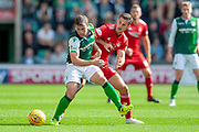 Lewis Stevenson (#16) of Hibernian FC holds off Dominic Ball (#21) of Aberdeen FC during the Ladbrokes Scottish Premiership match between Hibernian and Aberdeen at Easter Road, Edinburgh, Scotland on 25 August 2018.