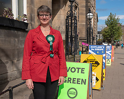 Maggie Chapman, top of the Scottish Green Party list in the European Election, doing her bit standing outside her local polling place in Portobello this morning.<br /> <br /> <br /> © Jon Davey/ EEm